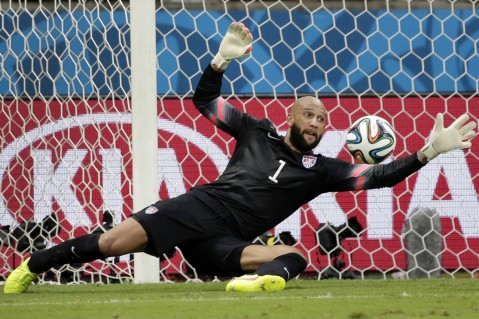 Tim Howard with one of his 16 saves against Belgium